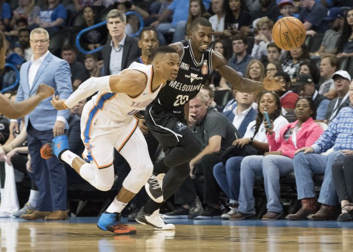 Casey Prather battles with Thunders' Russell Westbrook in the NBA pre-season clash. Picture: Getty Images