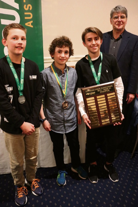 Vic Park Squash Club member and under 13 boys title winner Oscar Curtis (second from right) with runner-up Benjamin Murray, third-place Andre Lynn and Squash Australia president David Mandell.