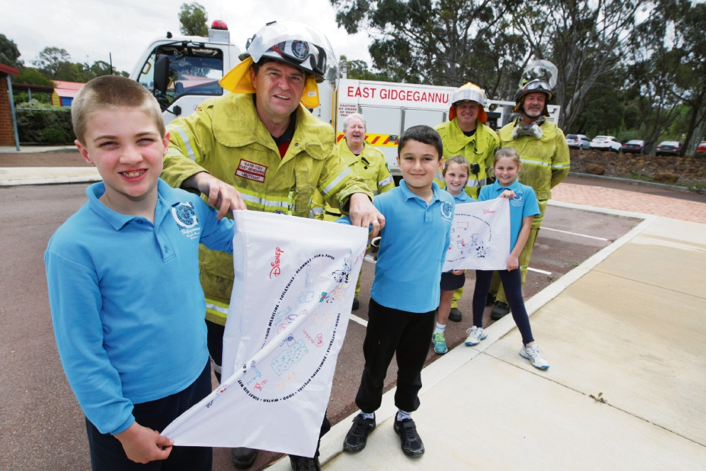 Gidgegannup Primary students Patrick Atwood, Khaled Howlett, Keila Mayger and Molly Beagley with bushfire crew David Cole, Andrew Watt and Shane Atwood from East Gidgegannup bush fire brigade. Picture: Bruce Hunt