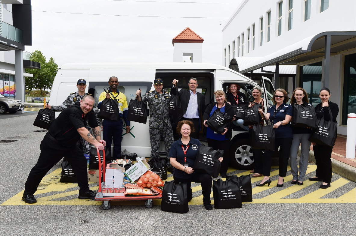 Adam McLachlan and Soup Kitchen manager Katie Stallard with WAMA Alliance Management Office governance & assurance officer Nola Patricia and   Warship Asset Management Agreement personnel. Picture: Jon Hewson    d474885