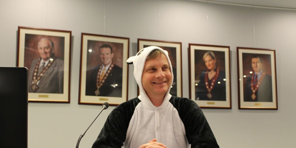 Outgoing City of Vincent councillor Matt Buckels in his gifted panda onesie. Picture: Julian Wright