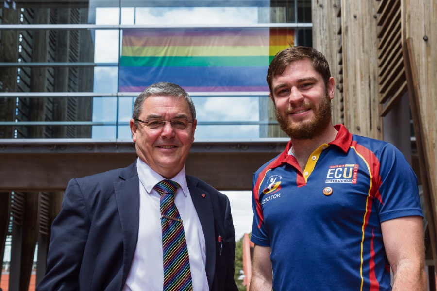 ECU Vice-Chancellor Steve Chapman with Guild president Sam Martyn and the rainbow flag flying nehind them.