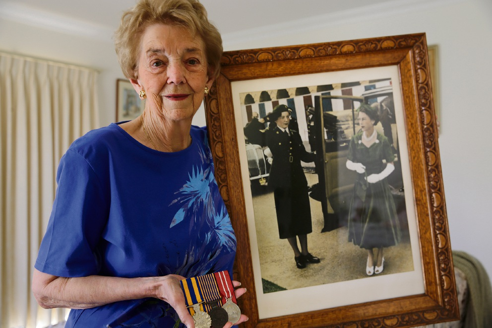 Hazel Donald with her medals and a photograph of her with the Queen. Ms Donald has been chosen as one of the Queen's baton bearers for the Commonwealth Games.  Picture: Andrew Ritchie  d475356