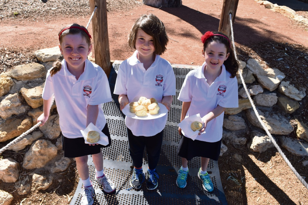 West Balcatta Primary School students Eva Rudd (8), Charlie Parker (7) and Jaida Dragicevic (6) show off their scones.