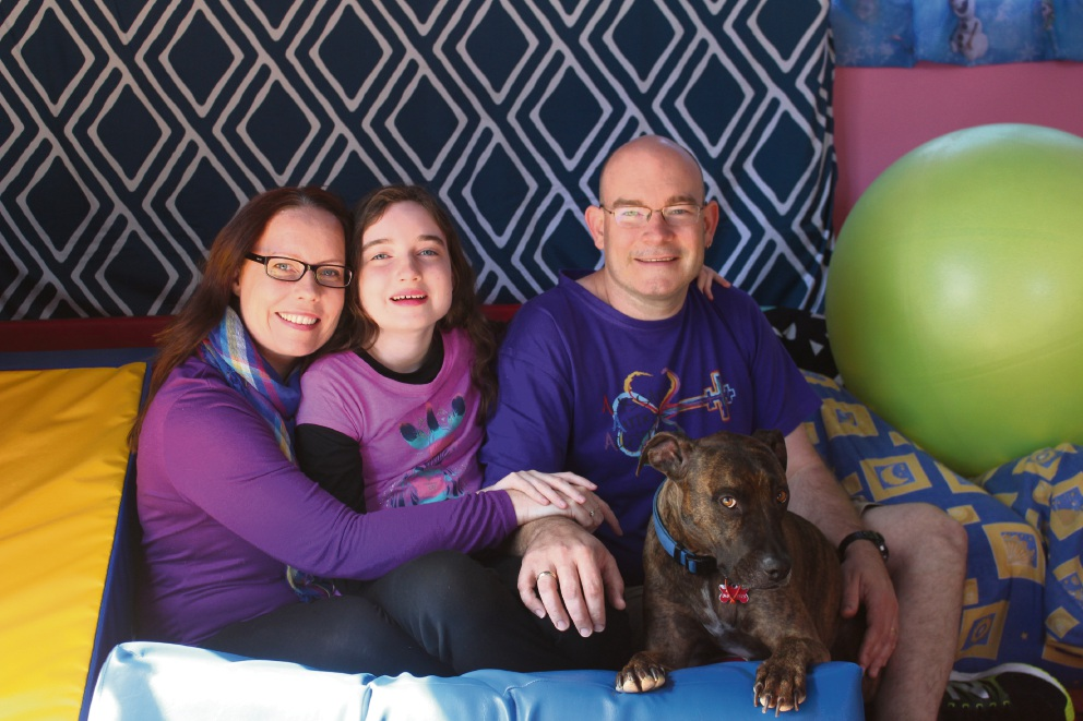 Rhona, Alyssa and Clay Bolger with their dog Zappa.
