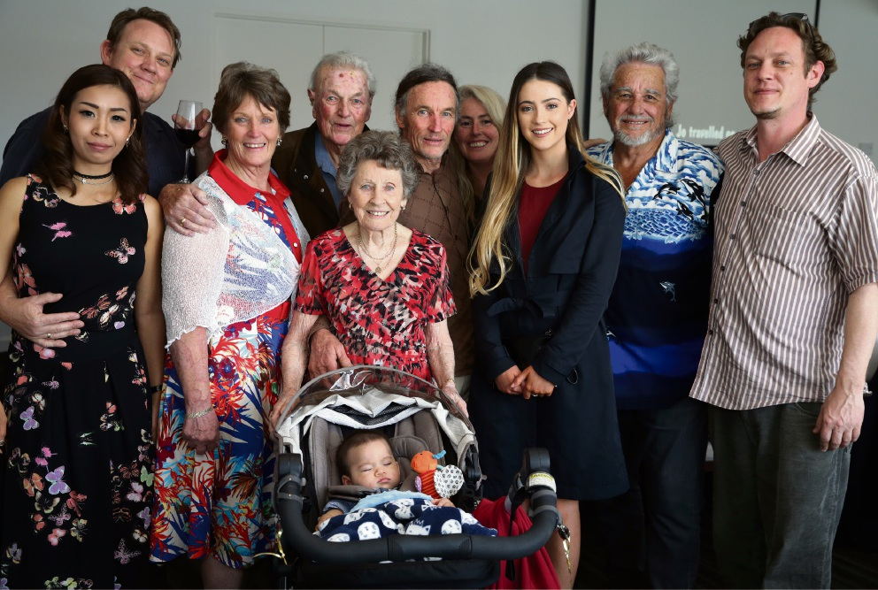 90-year-old Jo Briand with her husband Vic and family. Picture: Martin Kennealey d475122