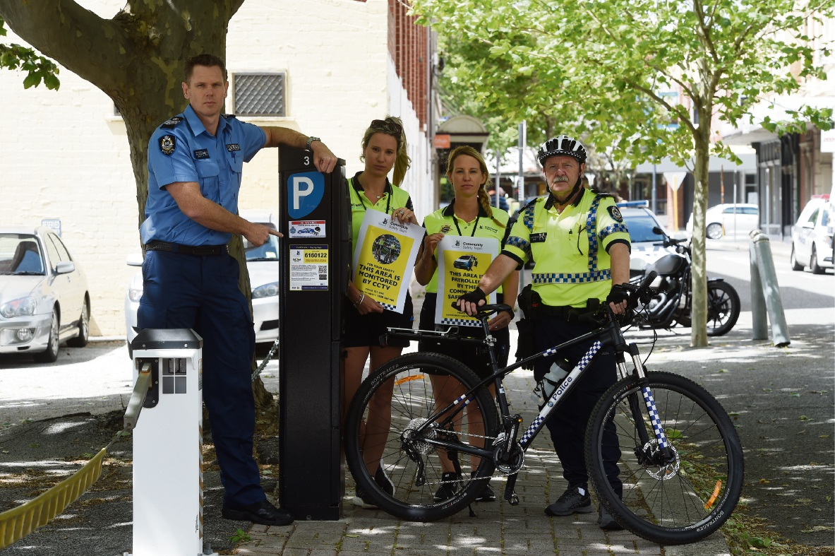 Snr Sgt Brad Warburton with Community Safety Officers Hannah Bickford and Lisa Hilliard and Snr Constable Mark Matthews displaying action stickers to be placed at ticket parking machines.  Picture: Jon Hewson    d475065