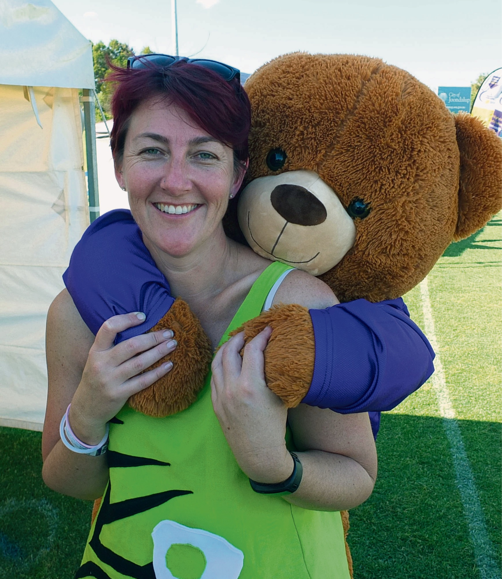 Stacey Johnson of the One Step, Two Step team with the Relay Bear.