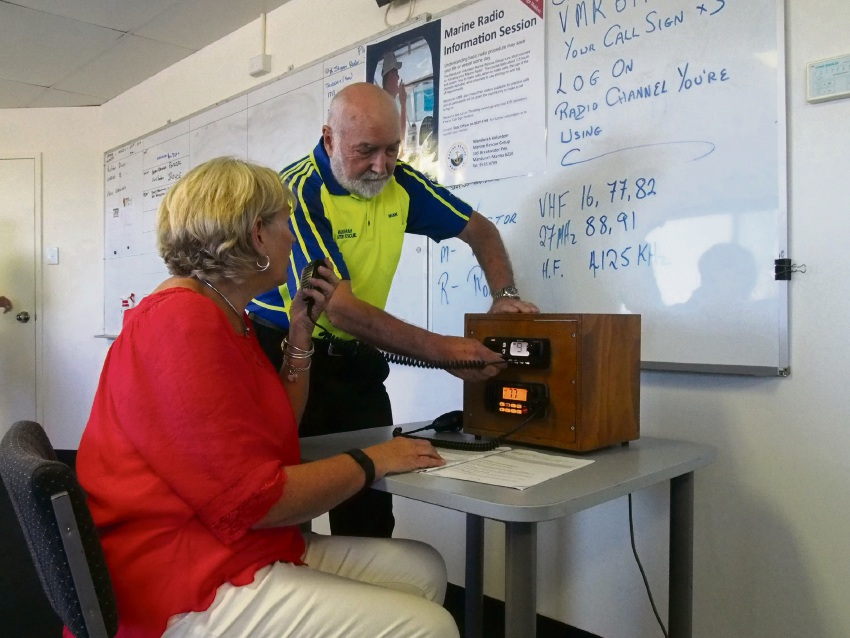 Brian Muir shows Gail Summers how to use a radio.