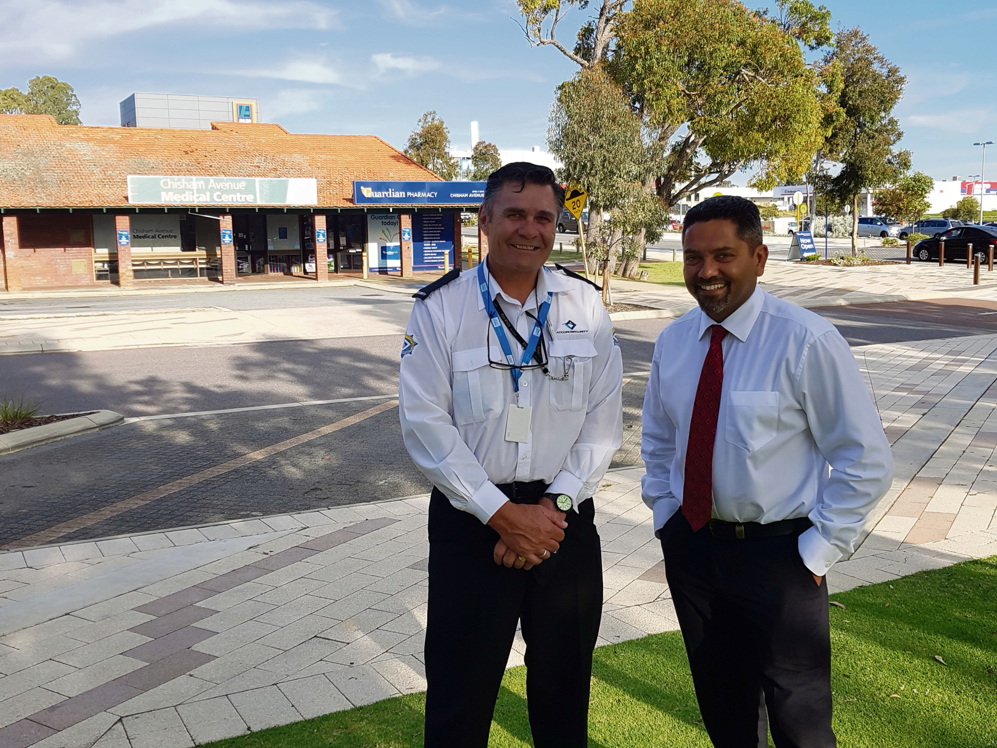 Accord security guard David Whitehead with Guardian Chisholm Avenue pharmacist David Henrisson.