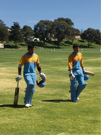 Darius D'Silva and Robert Jones walk off the field after their record-breaking stand for South Perth.
