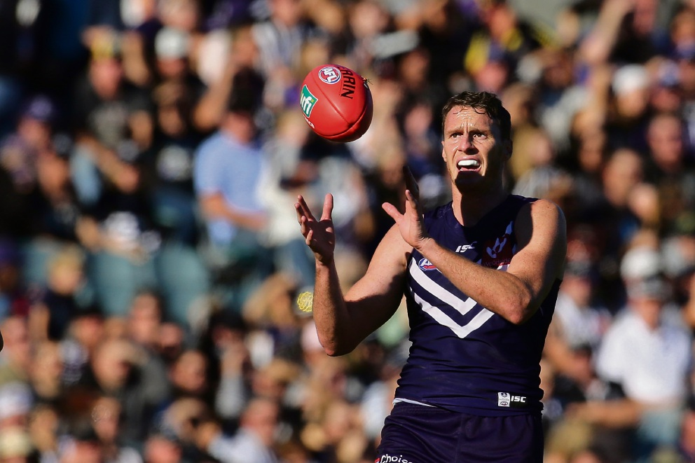 Jonathon Griffin of the Dockers marks the ball during the round 11 AFL match between Fremantle and Collingwood at Subiaco Oval. Picture: Will Russell/AFL Media/Getty Images