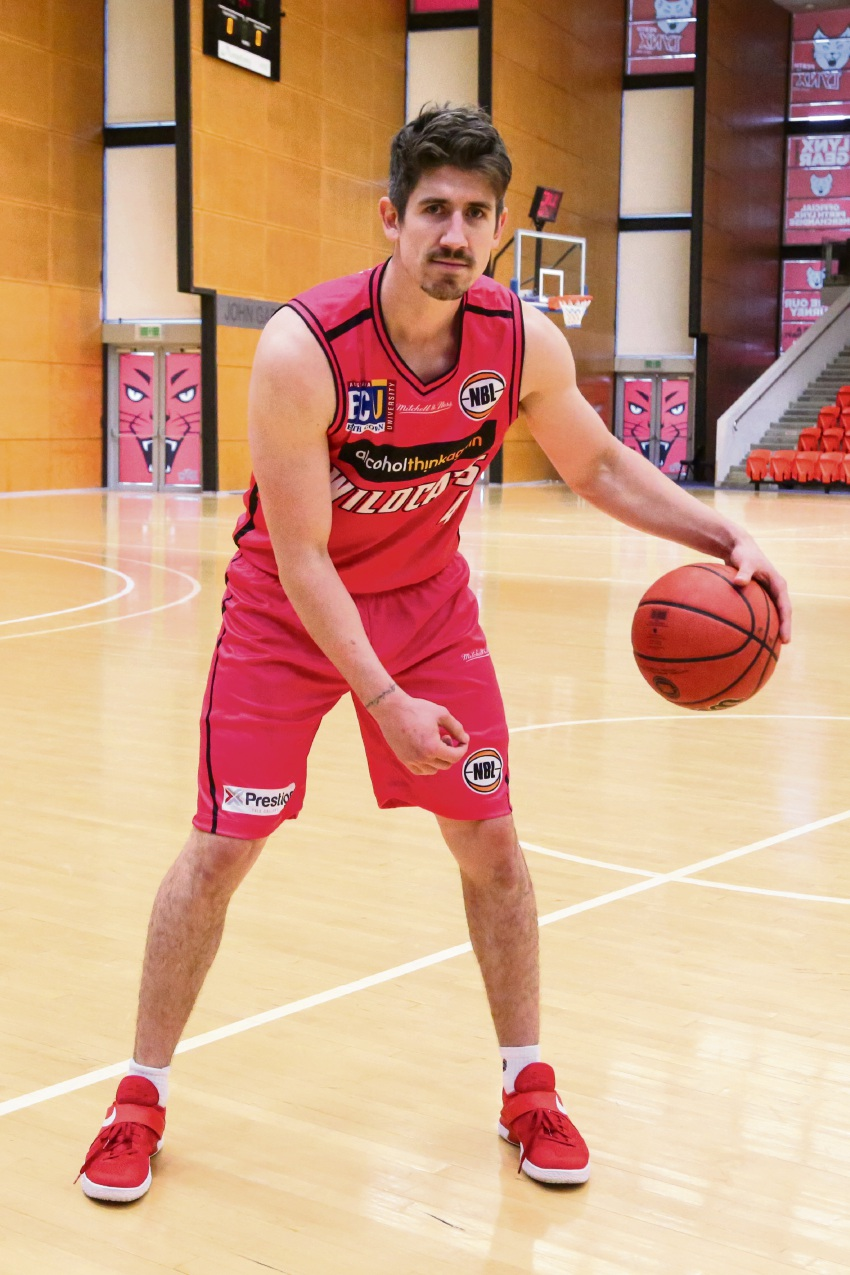 Greg Hire in the pink uniform the Wildcats will be wearing tonight against Illawarra.