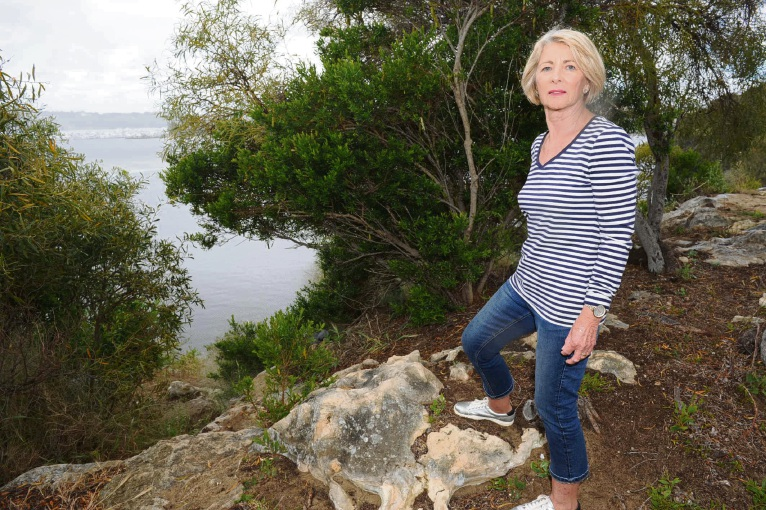 Yvonne Barron on the cliff path thieves escaped to their tinny at Rocky Bay, North Fremantle. Picture: Jon Bassett