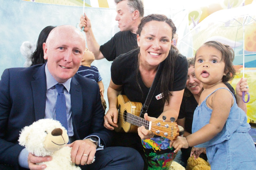 Disability Services Minister Stephen Dawson with Sensorium Theatre artist Amity Culver and Chyna Smith during a Sensorium story time event at the Canning Bridge Library Lounge in Applecross on Wednesday. Mr Dawson used the gathering to hand Sensorium Theatre a $105,000 Lotterywest grant.