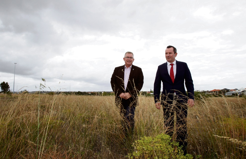 WA Premier Mark McGowan (right) with Burns Beach MLA Mark Folkard on the site in Burns Beach where a new $15.6 million primary school will be built. Picture: Marie Nirme