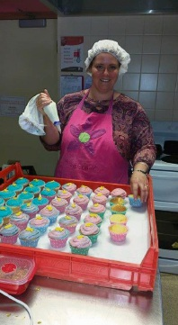 Kristy Pepper with some of the cupcakes.