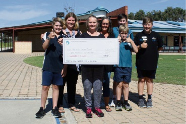Teachers and students with their cheque for $1013.