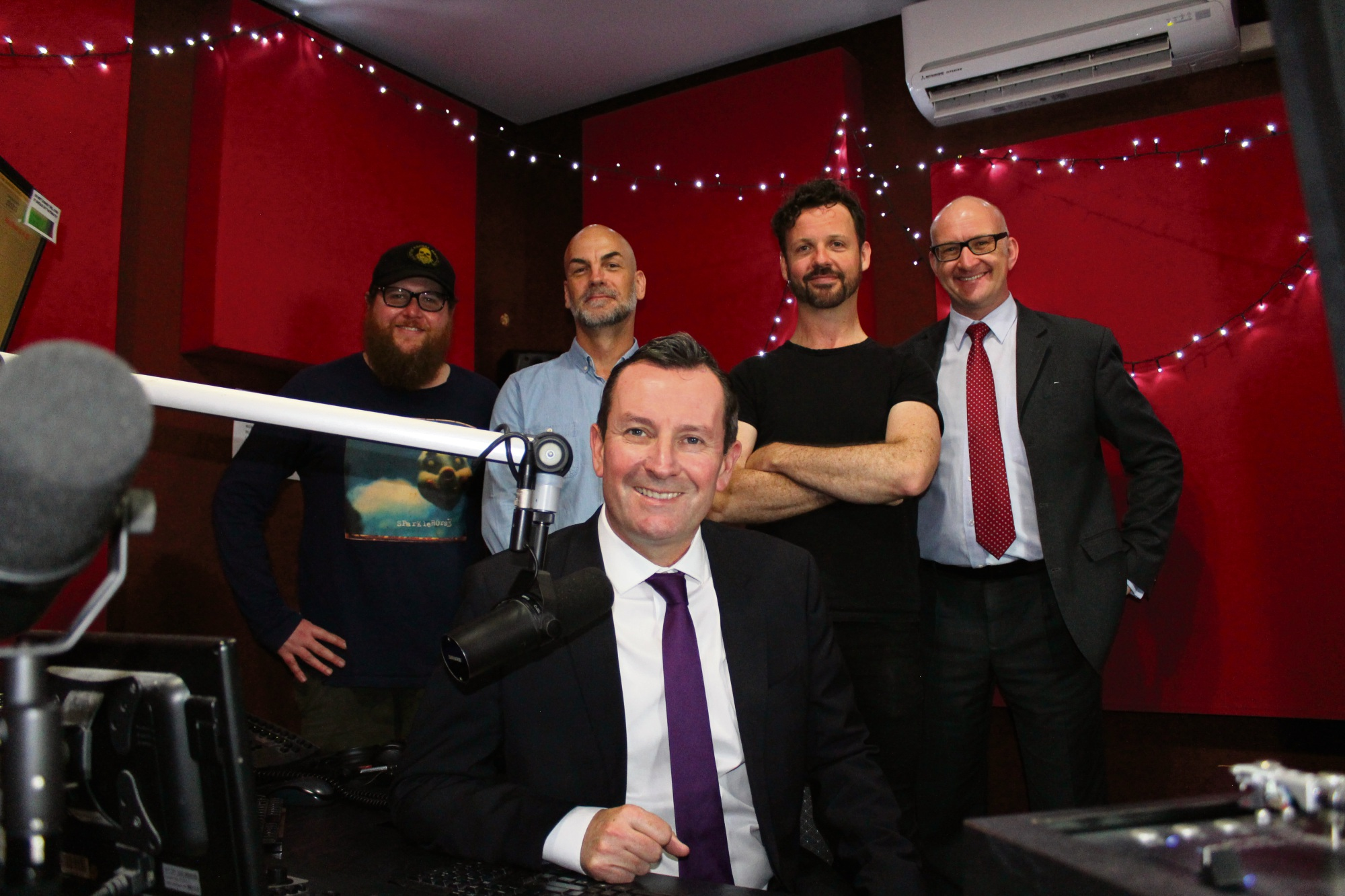 WA Premier Mark Mcgowan (front) with RTRFM board members and presenters James Hall and John Vojkovich, station general manager Stuart MacLeod and Mt Lawley MLA Simon Millman.