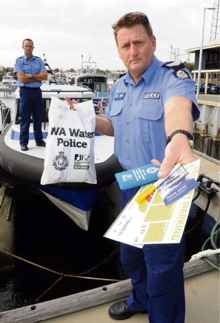 Sergeants Rod Veal (front) and Alan Trist want boaters to tackle safety and crime this summer. Picture: Jon Bassett.