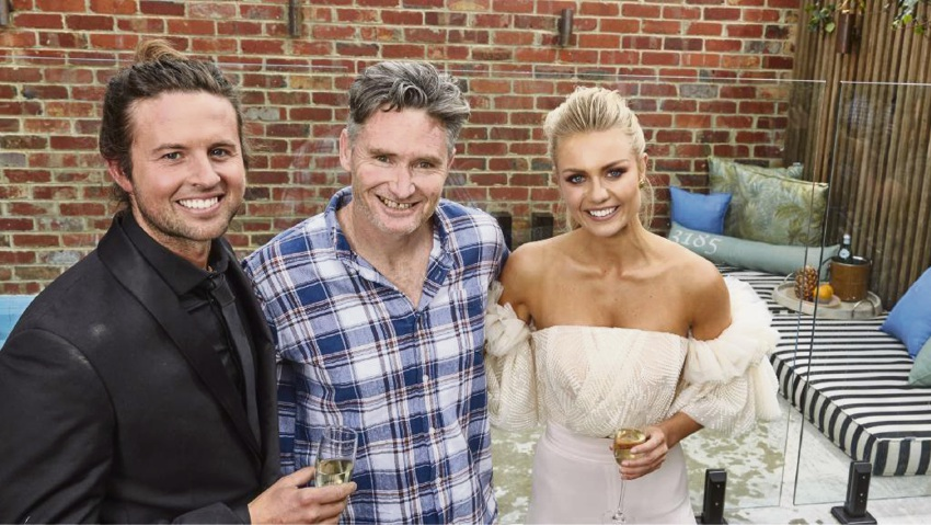The Block season 13 winners Josh and Elyse with the owner of their new home, comedian Dave Hughes.