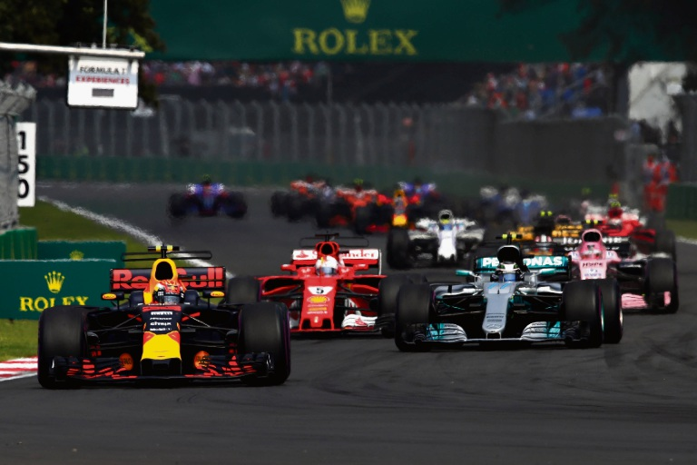 Max Verstappen's Red Bull leads Lewis Hamilton (Mercedes) and Sebastien Vettel (Ferrari) on the opening lap. Picture: Getty Images