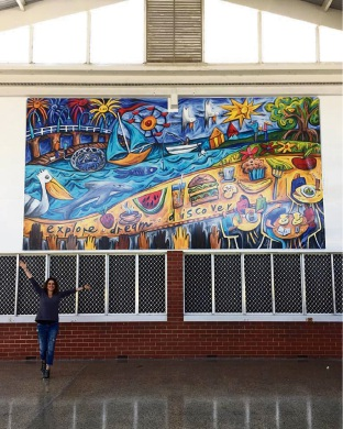 Mandurah artist transforms spaces with colourful murals and help from Glencoe students