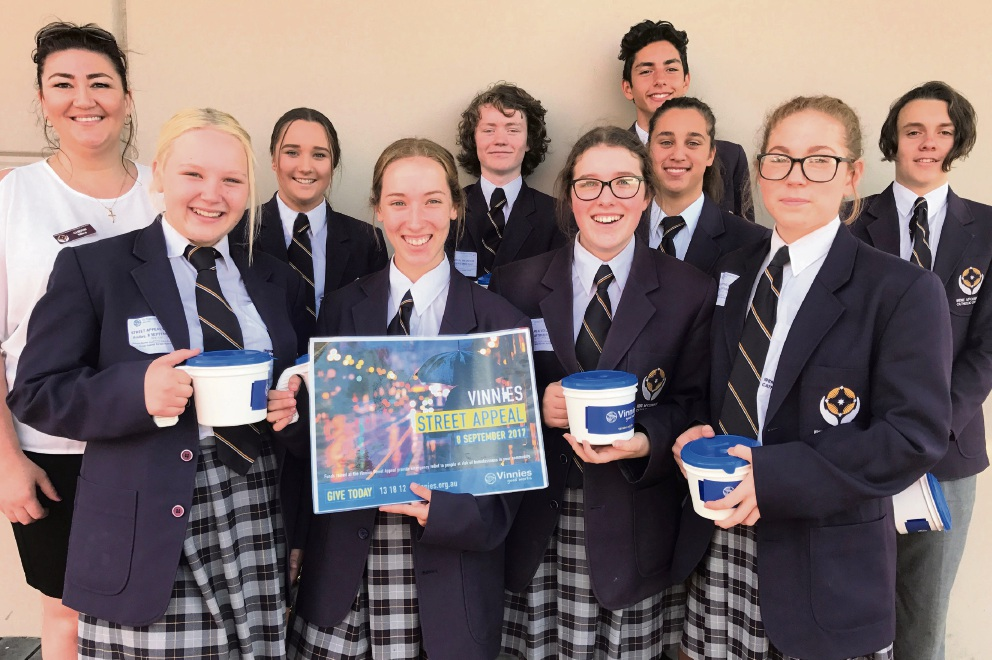 Irene McCormack Catholic College's service learning co-ordinator Cherie Milne with the Years 10 and 11 students.