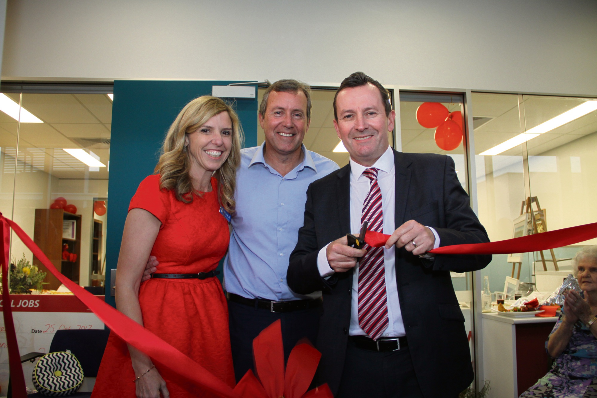 Natalie and Reece Whitby with Mark McGowan at the opening of Mr Whitby's new Baldivis office.