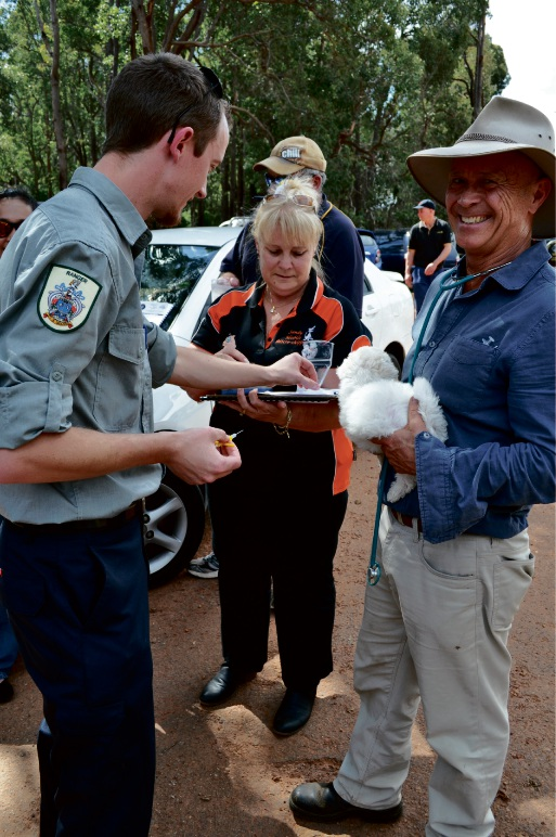 Student ranger Simon Allingham, industry expert Sandy Bariaolo and supervising veterinarian Dr John Tyrrell.