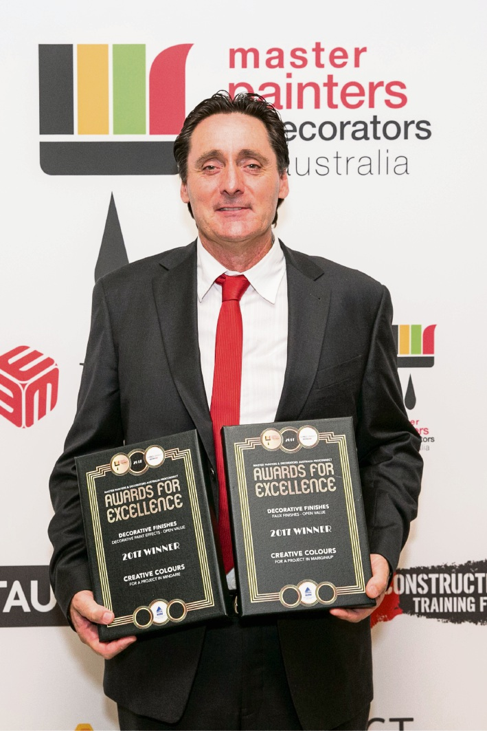 Karl Saxon with the awards from Master Painters and Decorators Australia.
