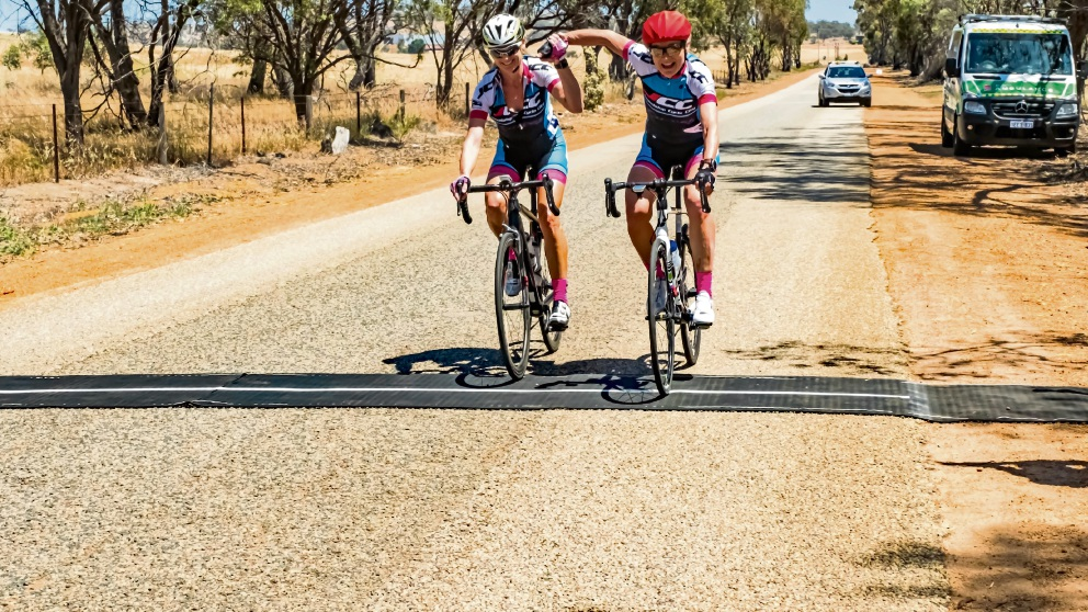 Kylie Anticich and Anna Heitz in a breakaway win for their respective State Championships. Picture: Peter Walpole