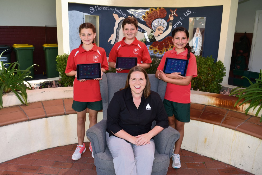 Money School director and 'shark' judge Lacey Filipich (centre) with St Michael's School Year 6 students Emily Walsh, Jaden Heys and Lara Tucker.