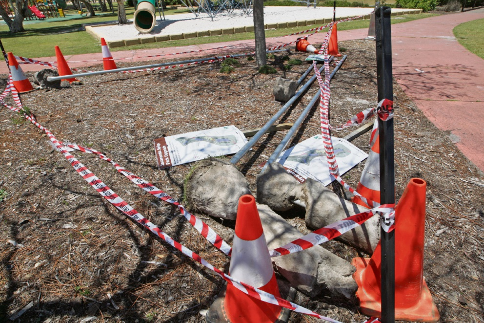 Sign posts and light poles vandalised at Jacaranda Springs Park. Picture: Bruce Hunt
