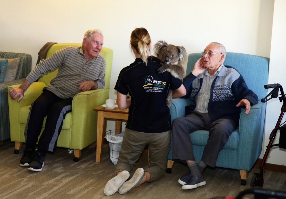 Cindi Howlett (West Oz Wildlife) and Judah, with residents Jim Mollon and Bernard Ashdown. Picture: Martin Kennealey d475107