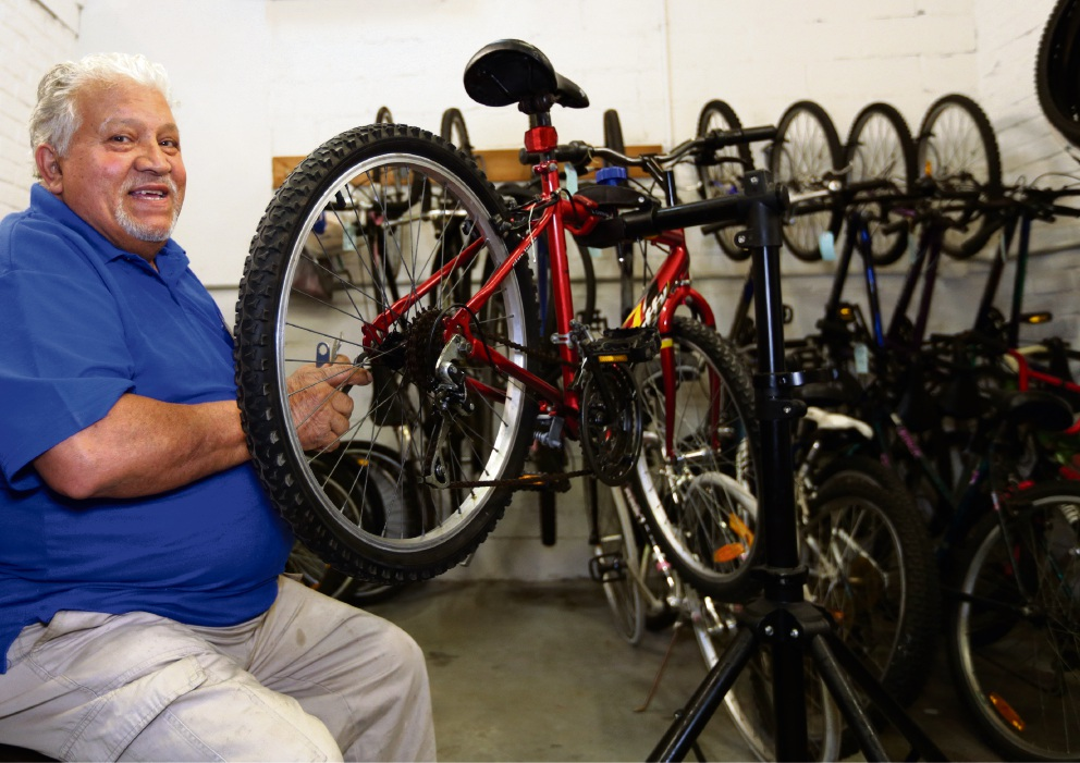 Joe Nastisi fixing up bikes at Belmont Men's Shed. Picture: Martin Kennealey www.communitypix.com.au d475579