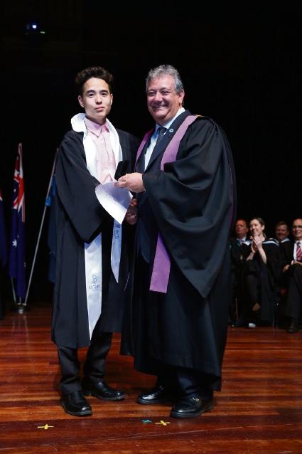 Principal Armando Giglia with VET dux Ryo Evans.