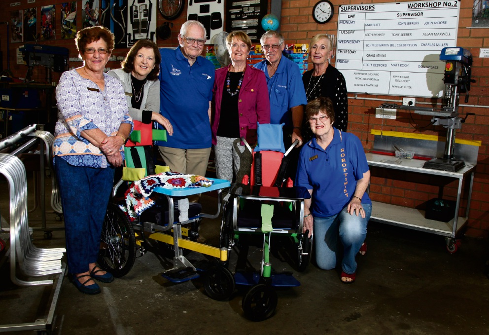 Wheelchair for Kids chief executive Gordon Hudson and workshop manager Brother Ollie Pickett with the ladies from Soroptimist International of Joondalup (L-R) Claire Parry, Susan Cromb, Gwen Browning, Sylivia Takiari and Jill Broom. Picture: Marie Nirme d475319