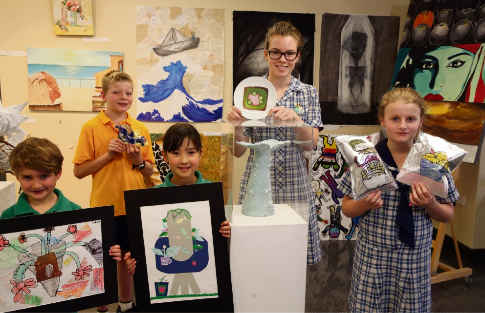 Lachie Leadon, Sebastian Foufas, Ruth Duuring, Amy Macdonald and Paige Sayers with their food-themed artwork.  Picture: Martin Kennealey d475664