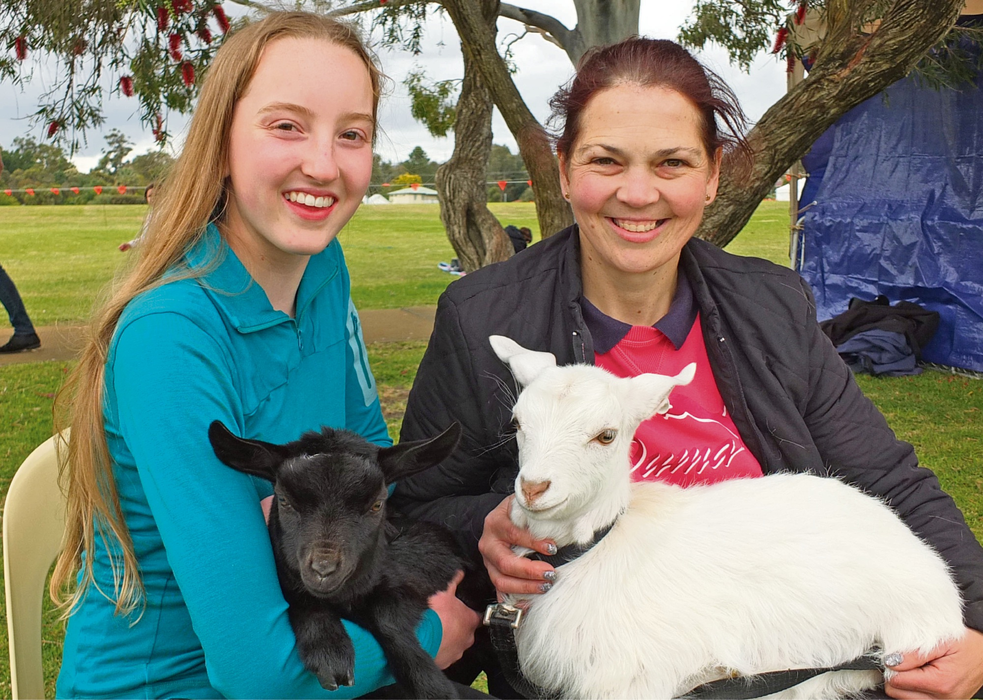 Bella Langfield with Millie, a pygmy goat, and Petrina Porter with Sophia, a three-month-old Australian Miniature Goat.