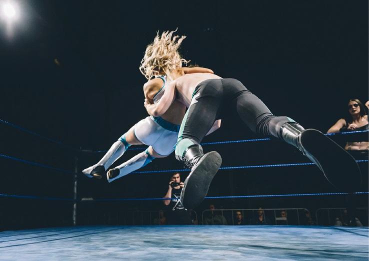 Allyson Holmes (white shorts) takes flight.