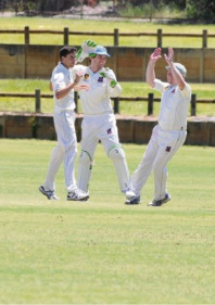 Matt Hanna (left) celebrates one of his wickets with teammates.