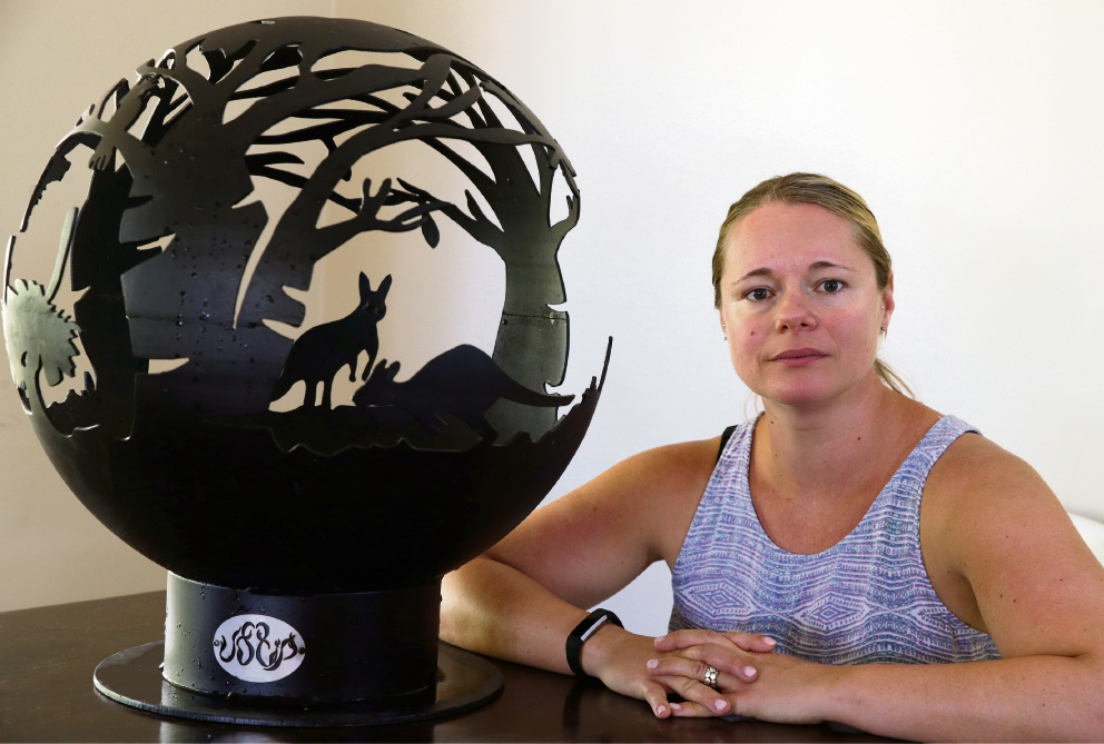 Jenny Oldham with one of her fire pits. Picture: Martin Kennealey d476264