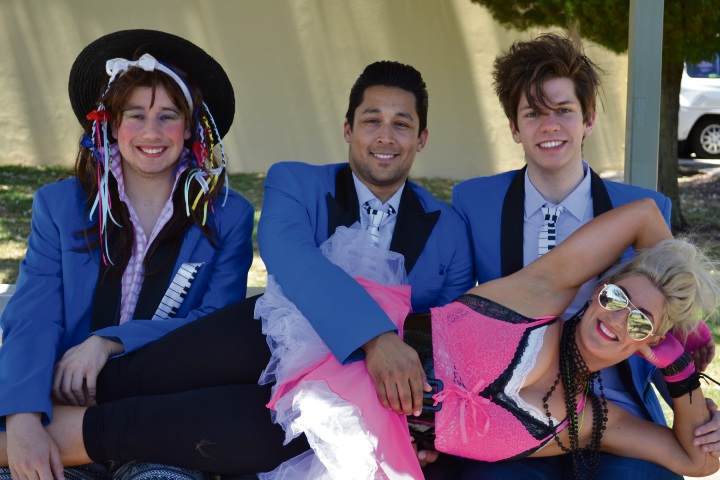 In The Wedding Singer, Holly (Dixie Johnstone) shows off how pretty in pink she is with George (Oliver Kaiser), Robbie (Ashby resident Jared Herft) and Sammy (Emerson Brophy). Picture: Gillian Binks