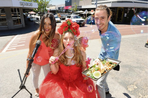 It will be a music, fund and food at the Cottesloe Village Christmas Party with (l-r) singer Asrid Riperi, Fairy Claire and Van's Cafe manager Anton Koutny. Picture Jon Bassett