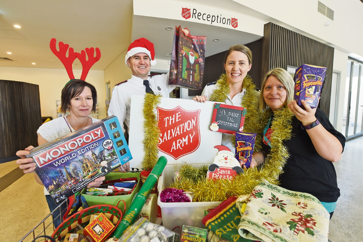 Sharon Tregear, left, Darrell and Chelsea Wilson and Carisa Watson from the Rockingham Salvation Army. Picture: Jon Hewson.