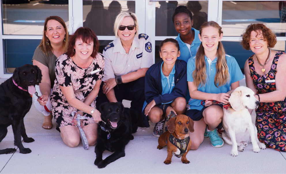 Nat Foster (RSPCA), with Alkimos Primary School staff members Sarah Chaloner, Sara Sparks and Sue Grant, Year 6 students Taysha Dudley, Jennifer Kilanga and Kylie Broughton as well as Shelby, Poppy, George and Bertie. Picture and expert caption taking skills: Martin Kennealey.