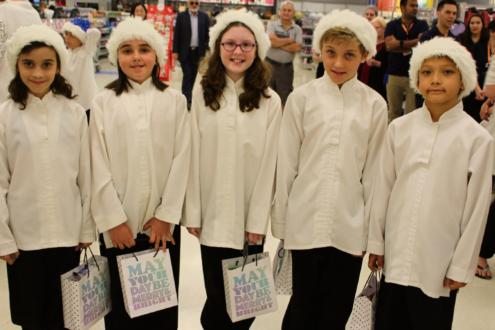 Kewdale Primary School choir members Alexis Davies, Madison Every, Emily Kidd, William Tilbee and Riley Clayton brought some Christmas cheer to Kmart at Belmont Forum.