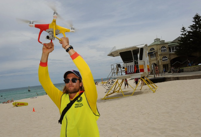 Australia Surf Lifesaving lifeguard  Michael Heldsinger lands a drone at Cottesloe Beach. Picture Jon Bassett