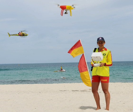 883f99143e9be Australia Surf Lifesaving lifeguard Honor Lane flies the drone with the  helicopter